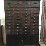 Antique apothecary bank of drawers